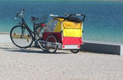 Bike and cab on the beach stock photo