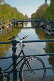 Bike and canal in Amsterdam Royalty Free Stock Photography