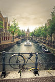 A bike and a canal in Amsterdam Royalty Free Stock Images