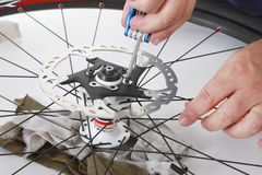 Bike care. Cyclist/biker taking care of his bike Stock Photography