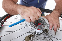 Bike care. Cyclist/biker taking care of his bike Royalty Free Stock Photos
