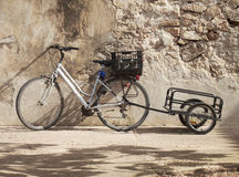 Bike and a carry case in a wall. Stock Photography