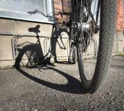 Bike casting shadow Royalty Free Stock Image