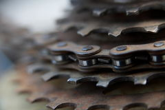 Bike Chain Gears. Close up of a rusty old bike chain and sprocket gears Royalty Free Stock Image