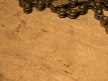 Bike chain on wooden table Royalty Free Stock Photography