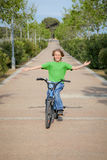 Bike child. Confident child riding bike or bicycle Royalty Free Stock Images