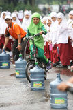 Bike. Children Islamic schools following the stunt riding game in Solo Central Java Indonesia Stock Images