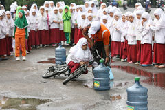 Bike. Children Islamic schools following the stunt riding game in Solo Central Java Indonesia Royalty Free Stock Photo