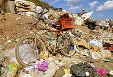 Bike in a city dump Stock Photos