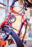 Bike in the city: Front picture of a city bike, blurred background. Front picture of a city bike, head lamp and blurry background bicycle mobility urban tour royalty free stock photos