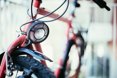 Bike in the city: Front picture of a city bike, blurred background. Front picture of a city bike, head lamp and blurry background bicycle mobility urban tour royalty free stock image