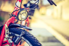 Bike in the city: Front picture of a city bike, blurred background. Front picture of a city bike, head lamp and blurry background bicycle mobility urban tour royalty free stock photo