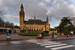Free Bike Commuters In Front Of The Peace Palace Royalty Free Stock Images - 174591319