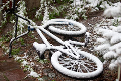 Bike completely covered with snow in the month of may Stock Images