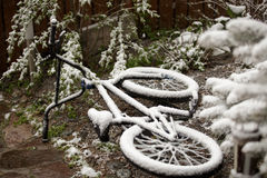 Bike completely covered with snow in the month of may Royalty Free Stock Image