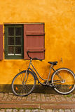 Bike and cottage. Bike parked in front of a rustic cottage Stock Image