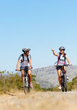 Bike couple. Happy carefree mountain bike couple cycling outdoors and leading a healthy lifestyle Stock Images