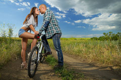 Bike couple. Kissing in field Stock Photos