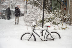 Bike covered with fresh snow in Montreal stock images