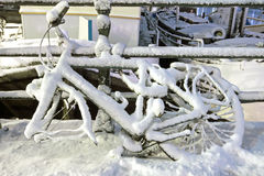 Bike covered with snow Stock Photos