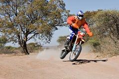Bike desert race. Bike riders in the Botswana Kalahari Desert Race 1000, sport series stock photo