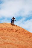 Bike Downhill on red hill Royalty Free Stock Images