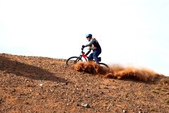 Bike Downhill on red hill Stock Photos