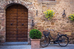 Bike at the empty street. Bike standing at the empty street of old italian town Stock Photo