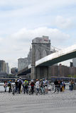 Bike excursion with tour guide  under Brooklyn Bridge Stock Images