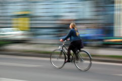 Bike fast. Girl ride on a bicycle very fast in Budapest street royalty free stock image
