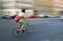 Bike fast. Boy ride on a bicycle very fast in Budapest main street royalty free stock image