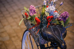Bike and flowers. Purple bike with colorful flowers in a basket Stock Image