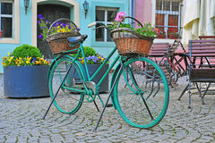 Bike with flowers in the street. Of Sighisoara, Romania Royalty Free Stock Photography
