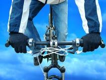 Bike-fly. A jumping biker in winter Stock Photos