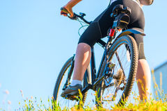 Bike and foot athlete Stock Images
