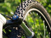 Bike Front. The front part of a bike showing the tire and suspension front fork Stock Images