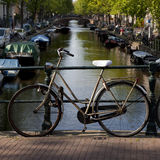 Bike in front of Amsterdam canal Stock Photography