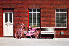 Bike in Front of a Brick Facade Royalty Free Stock Photo
