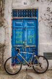 Bike front of the door Stock Images