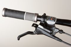 Bike front gear switch, brake lever and grip on handlebar on mou. Ntain bike Royalty Free Stock Photo