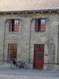Bike in front of an old building in Copenhagen, Denmark royalty free stock images