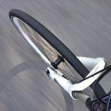 Bike front wheel in motion stock photo