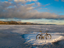 Bike on frozen Lake Laberge, Yukon, Canada Royalty Free Stock Images