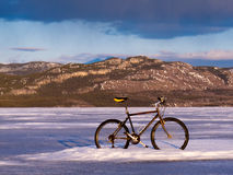 Bike on frozen Lake Laberge, Yukon, Canada Royalty Free Stock Photo