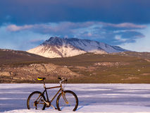 Bike on frozen Lake Laberge, Yukon, Canada Royalty Free Stock Photos