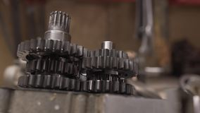 Bike gearbox repair on the table moving slider stock video footage
