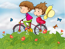 A bike with a girl and a boy Royalty Free Stock Image