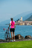 Bike girl looks forward. Road bike woman likes the view bay a break Royalty Free Stock Images