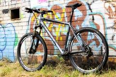 Bike and Graffiti wall Stock Images