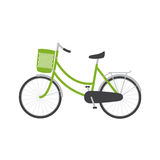 Bike. With green colored female frame with pannier on handlebar, rear rack, big dark grey saddle, big wheels with mudguards. Logo template, design element Stock Photo